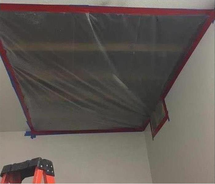 containment plastic covering hole on ceiling